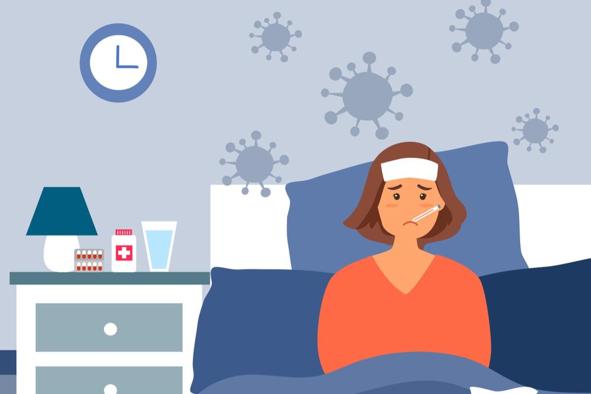 efectele fiziologice ale febrei. femeie racita cu un termometru in gura si compresa pe frunte